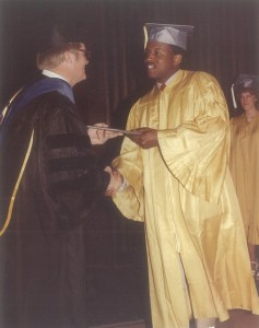 Rob Harleston receives his diploma from Professor Jim Null at 1983 UCCS Commencement ceremonies